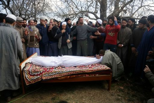 (AP Photo/Mukhtar Khan). A Kashmiri man weeps over the body of civilian Suhail Ahmad during his funeral at Pinjura village 52 kilometers (33 miles) south of Srinagar, Indian controlled Kashmir, Monday, March 5, 2018. More than a dozen protests erupted ...