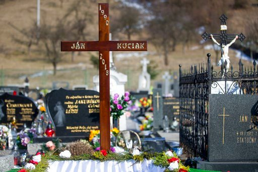 (AP Photo/Bundas Engler). The cross over the grave before the funeral of investigative journalist Jan Kuciak in Stiavnik, Slovakia, on Saturday, March 3, 2018. Kuciak an investigative journalist shot dead in Slovakia last week was working on a story ab...