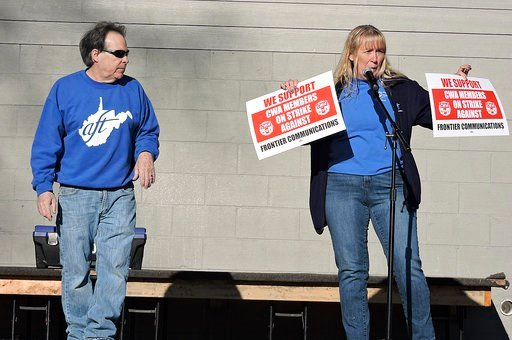 (Eddie Trizzino/Times-West Virginian via AP). Frank Caputo, AFT?staff representative and AFT?vice president Stacey Strawderman speak in support of the Communications Workers of America strike which began Sunday at a teachers rally in Palatine Park in F...