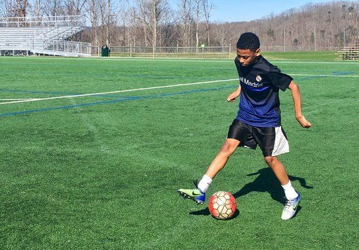 "(AP Photo/John Raby). In this Feb. 27, 2018, photo, C.J. Napper works on his soccer moves in South Charleston, W.Va. Napper said he was in no rush to get back to classes. ""I don't like school. It's not fun,"" Napper said. ""I don't mind"" the walkout."