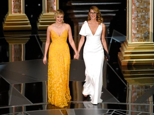 (Photo by Chris Pizzello/Invision/AP). Greta Gerwig, left, and Laura Dern walk on stage to present the award for best documentary feature at the Oscars on Sunday, March 4, 2018, at the Dolby Theatre in Los Angeles.