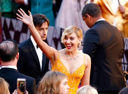(Photo by Eric Jamison/Invision/AP). Greta Gerwig arrives at the Oscars on Sunday, March 4, 2018, at the Dolby Theatre in Los Angeles.