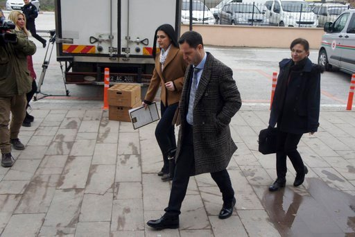 (AP Photo/Ergin Yildiz). Hakan Yalcintug, center, and Simge Sandir, left, lawyers for two arrested Greek soldiers, arrive at the courthouse in Edirne, Turkey, Monday, March 5, 2018. The lawyers for two Greek soldiers arrested in Turkey have formally re...