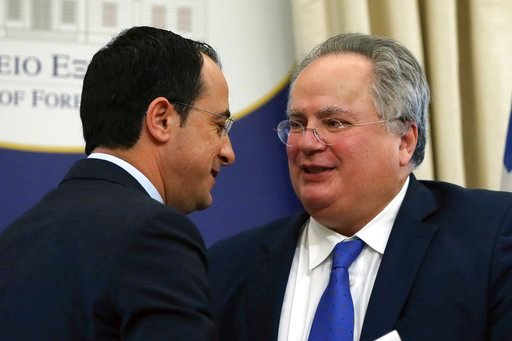 (AP Photo/Thanassis Stavrakis). Cypriot Foreign minister Nikos Christodoulidis, left, speaks with his Greek counterpart Nikos Gotzias after a news conference in Athens, Monday, March 5, 2018. Lawyers for two Greek soldiers arrested in Turkey have forma...