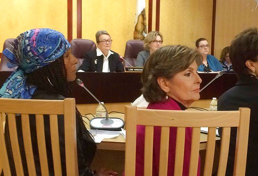 """(AP Photo/Don Thompson, File). FILE - In this April 12, 2016, file photo, Kelly Johnson, then referred to as """"Kacey,"""" front left, one of Bill Cosby's accusers, and attorney Gloria Allred, front right, attend a hearing at the State Capitol in Sacramento..."""
