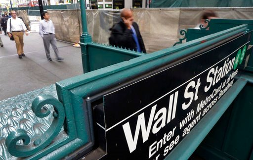(AP Photo/Richard Drew, File ). FILE- In this Nov. 21, 2014, file photo, the Wall Street subway stop on Broadway, in New York's Financial District. The U.S. stock market opens at 9:30 a.m. EST on Monday, March 5, 2018.
