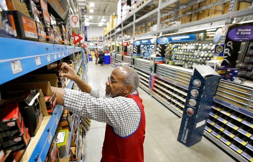 (AP Photo/Steven Senne). In this Friday, Feb. 23, 2018 photo sales associate Larry Wardford, of Holliston, Mass., places items on selves at a Lowe's retail home improvement and appliance store in Framingham, Mass. On Monday, March 5, the Institute for ...