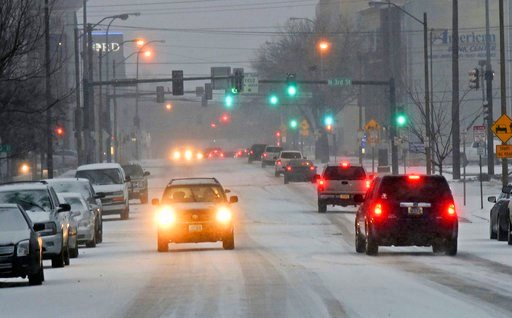 (Tom Stromme/The Bismarck Tribune via AP). Traffic moves down a snow covered street in Bismarck, N.D., Monday, March 5, 2018, as snow falls. Freezing rain, heavy snow and strong winds are blowing into the northern Plains, impacting travel, schools and ...