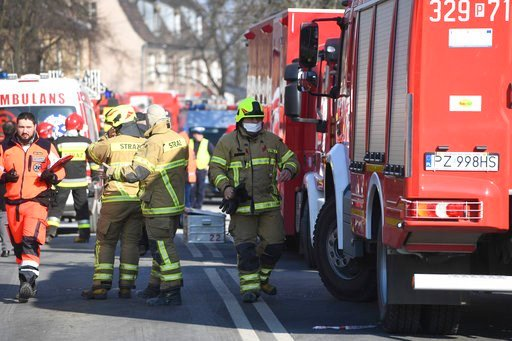 (AP Photo/Str). Firefighters and rescuers  work at the scene of a building collapse in Poznan, Poland, Sunday, March 4, 2018. An apartment block collapsed Sunday in Poland's western city of Poznan, killing several people and injuring more than 20 other...