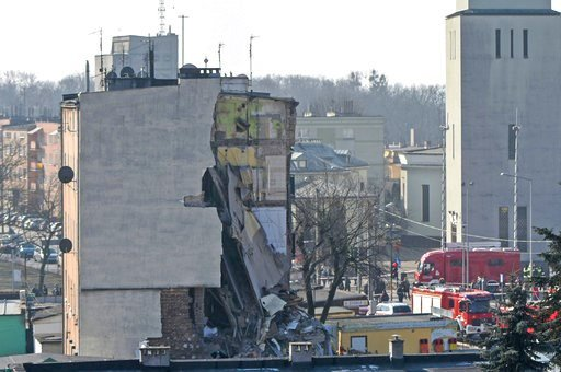 (AP Photo/Str). Rescuers work at a collapsed building  in Poznan, Poland, Sunday, March 4, 2018. An apartment block collapsed Sunday in Poland's western city of Poznan, killing several people and injuring more than 20 others, officials said as teams of...
