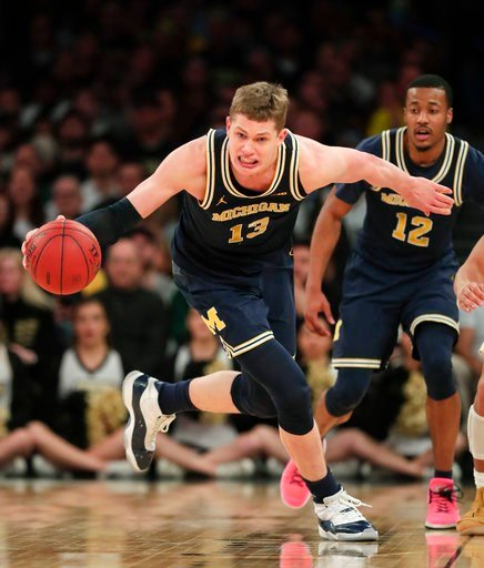 (AP Photo/Julie Jacobson). Michigan forward Moritz Wagner (13) makes a steal against Purdue during the second half of the NCAA Big Ten Conference tournament championship college basketball game, Sunday, March 4, 2018, in New York. Michigan won 75-66.