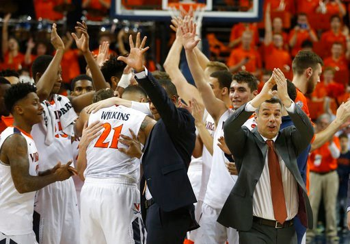 (AP Photo/Steve Helber). Virginia head coach Tony Bennett, right, applauds his team as they celebrate their 62-57 win over Notre Dame after an NCAA college basketball game in Charlottesville, Va., Saturday, March 3, 2018.