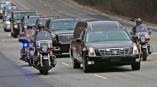 "(Kelly Wilkinson/The Indianapolis Star via AP). IMPD, Sheriff, and State Police officers travel on Meridian St. in Indianapolis as they escort the body of Boone Co. sheriff's deputy Jacob ""Jake"" Pickett from St. Vincent's Hospital downtown to the Mario..."