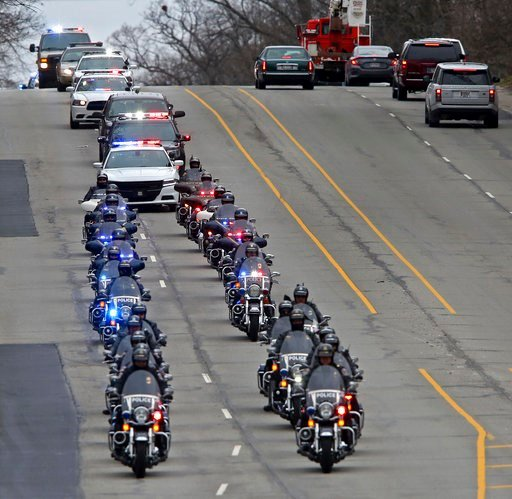 "(Kelly Wilkinson/The Indianapolis Star via AP). A long line of IMPD, Sheriff, and State Police officers continue their route down Meridian St. in Indianapolis as they escort the body of Boone Co. sheriff's deputy Jacob ""Jake"" Pickett from St. Vincent's..."