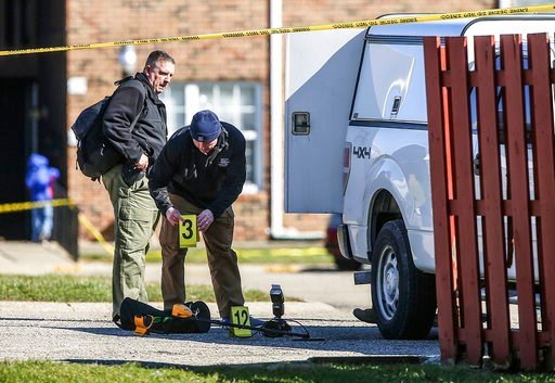 (Jenna Watson/The Indianapolis Star via AP). Police investigate the scene of a shooting, Friday, March 2, 2018 in Lebanon, Ind, Jacob Pickett, a central Indiana sheriff's deputy who was shot in the head while chasing three suspects won't survive and wa...