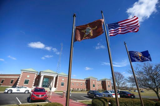 (Jenna Watson/The Indianapolis Star via AP). The Boone County Sheriff's Office flies their flags at half-staff to honor Deputy Jacob Pickett, Friday, March 2, 2018 in Lebanon, Ind, Jacob Pickett, a central Indiana sheriff's deputy who was shot in the h...