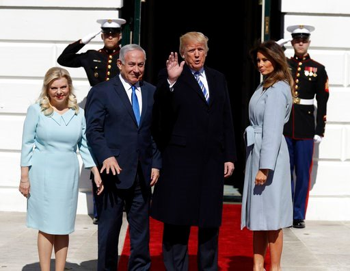 (AP Photo/Evan Vucci). President Donald Trump and first lady Melania Trump meet with Israeli Prime Minister Benjamin Netanyahu and his wife Sara Netanyahu as they arrive at the White House, Monday, March 5, 2018, in Washington.