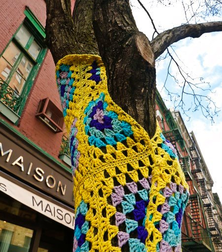 (AP Photo/Bebeto Matthews). One of more than a dozen trees on Christopher Street is shown decorated in crocheted patterns, Monday March 5, 2018, in New York. The New York City Parks Department says a cluster of trees in the West Village neighborhood ca...