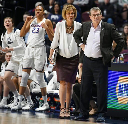 (AP Photo/Jessica Hill). Connecticut head coach Geno Auriemma and associate head coach Chris Dailey look at an official during the first half of an NCAA college basketball game against Tulane in the American Athletic Conference tournament quarterfinals...