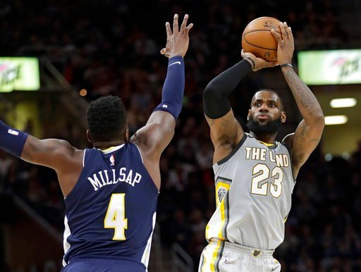 (AP Photo/Tony Dejak). Cleveland Cavaliers' LeBron James (23) shoots over Denver Nuggets' Paul Millsap (4) in the first half of an NBA basketball game, Saturday, March 3, 2018, in Cleveland.