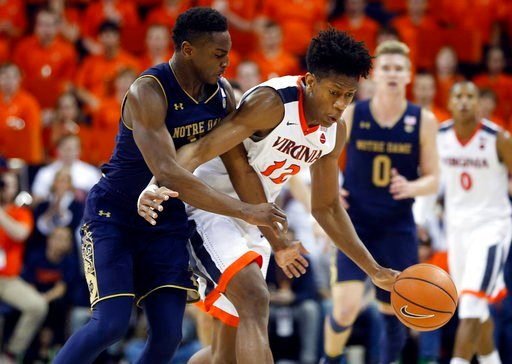 (AP Photo/Steve Helber). Virginia guard De'Andre Hunter (12) is fouled by Notre Dame forward Juwan Durham (11) during the second half of an NCAA college basketball game in Charlottesville, Va., Saturday, March 3, 2018. Virginia won the game 62-57.