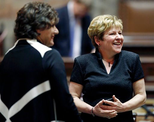 (AP Photo/Ted S. Warren, File). FILE - In this April 11, 2012, file photo, Senate Majority Leader Lisa Brown, right, D-Spokane, laughs with Sen. Tracey Eide, D-Federal Way, at the state Capitol in Olympia, Wash., after the Washington state Legislature ...