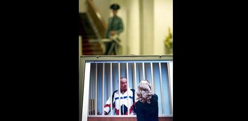 (AP Photo/Misha Japaridze, File). FILE - In this Wednesday, Aug. 9, 2006 file photo, Sergei Skripal speaks to his lawyer from behind bars seen on a screen of a monitor outside a courtroom in Moscow. It has been reported on Monday, March 5, 2018 by the ...