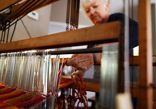 (AP Photo/Gregory Bull). In this March 2, 2018, photo, Christine Sheppard works with her loom in her home in Oceanside, Calif. Claims that the active ingredient in the widely used weed killer Roundup can cause cancer have been evaluated by internationa...