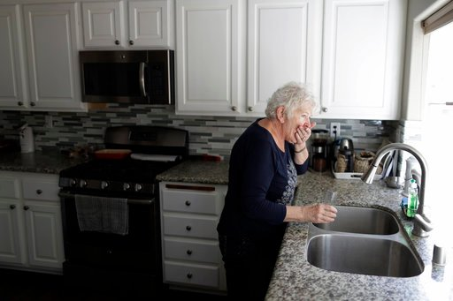 (AP Photo/Gregory Bull). In this March 2, 2018, photo, Christine Sheppard takes her medication at the home in Oceanside, Calif. Sheppard said she sprayed Roundup for years to control weeds on her coffee farm in Hawaii. Claims that the active ingredient...