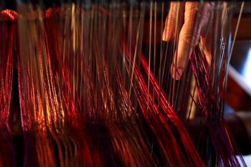 (AP Photo/Gregory Bull). In this March 2, 2018, photo, Christine Sheppard works with her loom in her home in Oceanside, Calif. In 2003, she was diagnosed with non-Hodgkin's lymphoma and given six months to live. Now 68, she is in remission but experien...