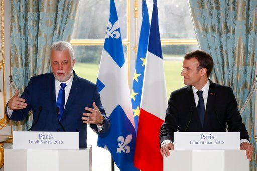 (Gonzalo Fuentes/Pool Photo via AP). Quebec Premier Philippe Couillard, left, and French President Emmanuel Macron hold a joint press conference following their meeting at the Elysee Palace in Paris, France, March 5, 2018.