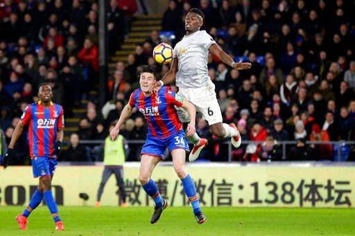 (AP Photo/Tim Ireland). Manchester United's Paul Pogba, right, competes for the ball with Crystal Palace's Martin Kelly during the English Premier League soccer match between Crystal Palace and Manchester United at Selhurst Park in London, Monday, Marc...