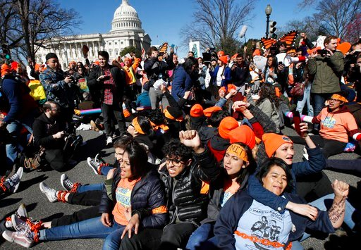 (AP Photo/Jacquelyn Martin). Ivon Meneses, of Las Vegas, bottom right, and Alondra Gomez, of Chattanooga, Tenn., who is a DACA recipient, and other supporters of the Deferred Action for Childhood Arrivals (DACA) program, chain themselves together as th...