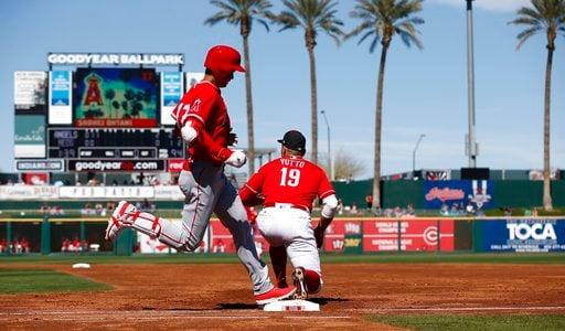 (AP Photo/Ross D. Franklin). Cincinnati Reds first baseman Joey Votto (19) makes the catch at first base to get Los Angeles Angels' Shohei Ohtani, left, of Japan, out during the third inning of a spring training baseball game Monday, March 5, 2018, in ...