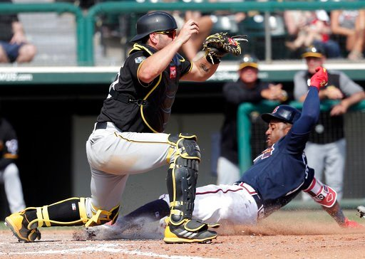 (AP Photo/John Raoux). Pittsburgh Pirates' Francisco Cervelli, left, makes the catch to force out Atlanta Braves' Ozzie Albies at home on a bases-loaded infield ground ball during the fifth inning of a spring baseball exhibition game, Monday, March 5, ...