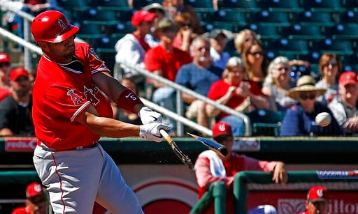 (AP Photo/Ross D. Franklin). Los Angeles Angels designated hitter Albert Pujols breaks his bat as he connects for a run-scoring single against the Cincinnati Reds during the third inning of a spring training baseball game Monday, March 5, 2018, in Good...