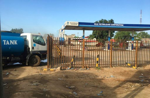 "(AP Photo/Sam Mednick, File). FILE - In this Sunday Oct. 1, 2017 file photo, a truck waits outside a closed petrol station of the Nile Petroleum Corporation in Juba, South Sudan. South Sudan's state-owned oil company has been ""captured by predatory eli..."