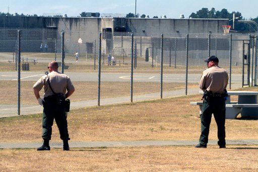 (AP Photo/Rich Pedroncelli, File). FILE - In this Aug. 17, 2011 file photo, correctional officers keep watch on inmates in the recreation yard at Pelican Bay State Prison near Crescent City, Calif. Gov. Jerry Brown will appeal a judge's ruling that Cal...