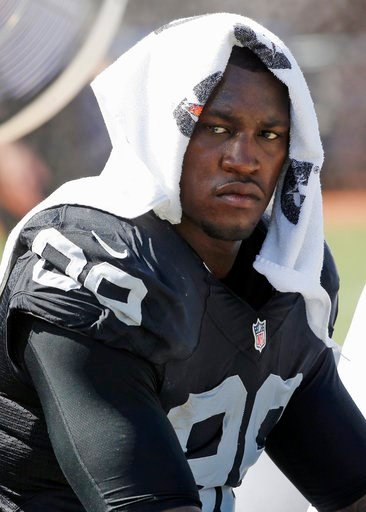 (AP Photo/Tony Avelar, File). FILE - In this Sept. 20, 2015, file photo, Oakland Raiders' Aldon Smith cools off during an NFL football game against the Baltimore Ravens in Oakland , Calif. Police are searching for suspended Smith, who is suspected of d...