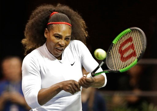 (AP Photo/Chuck Burton, File). FILE - In this Feb. 11, 2018, file photo, United States' Serena Williams returns a shot against the Netherlands during a doubles match in the first round of Fed Cup tennis competition in Asheville, N.C. Tennis great Chris...