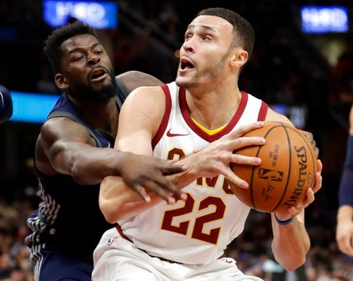 (AP Photo/Tony Dejak). Cleveland Cavaliers' Larry Nance Jr. (22) drives against Detroit Pistons' James Ennis (33) in the first half of an NBA basketball game, Monday, March 5, 2018, in Cleveland.