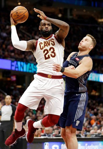 (AP Photo/Tony Dejak). Cleveland Cavaliers' LeBron James, left, drives against Detroit Pistons' Blake Griffin in the first half of an NBA basketball game, Monday, March 5, 2018, in Cleveland.