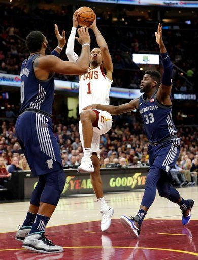 (AP Photo/Tony Dejak). Cleveland Cavaliers' Rodney Hood (1) drives between Detroit Pistons' Andre Drummond (0) and James Ennis (33) in the first half of an NBA basketball game, Monday, March 5, 2018, in Cleveland.