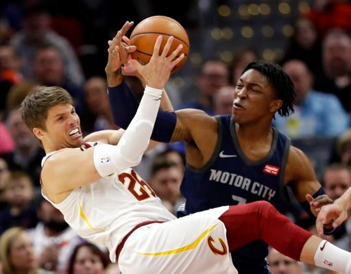(AP Photo/Tony Dejak). Cleveland Cavaliers' Kyle Korver, left, and Detroit Pistons' Stanley Johnson battle for a loose ball in the first half of an NBA basketball game, Monday, March 5, 2018, in Cleveland.
