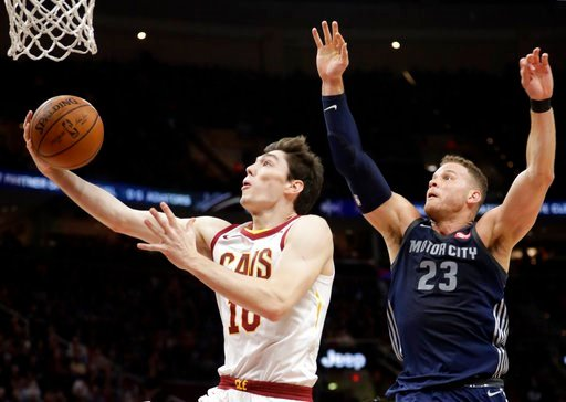 (AP Photo/Tony Dejak). Cleveland Cavaliers' Cedi Osman (16), from Turkey, drives to the basket against Detroit Pistons' Blake Griffin (23) in the first half of an NBA basketball game, Monday, March 5, 2018, in Cleveland.