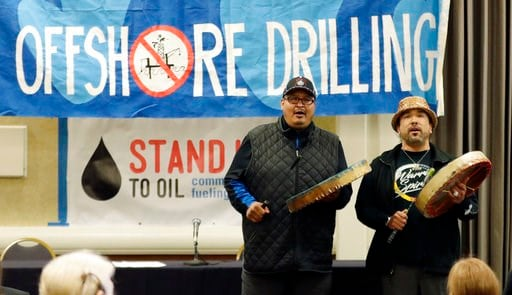 (AP Photo/Ted S. Warren). Jeff Choke, left, and Hwequidi Hanford McCloud, right, members of the Nisqually Indian Tribe, sing and play drums, Monday, March 5, 2018, at a hearing in Olympia, Wash., organized by a coalition of environmental groups opposed...