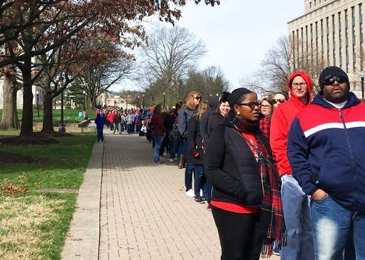 (AP Photo/John Raby). Striking West Virginia teachers line up Monday, March 5, 2018, to enter the state Capitol in Charleston, W.Va.