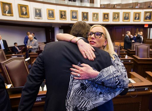 (AP Photo/Mark Wallheiser). Florida Sen. Lauren Book, right, embraces Sen. Bill Galvano after Galvano's bill, the Marjory Stoneman Douglas High School Student Safety Act, passed 20-18 at the Florida Capitol in Tallahassee, Fla., Monday, March 5, 2018.