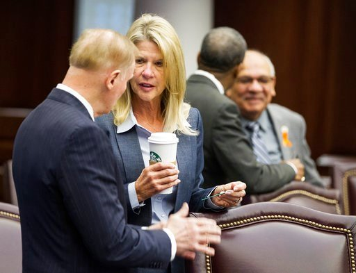 (AP Photo/Mark Wallheiser). Florida Sens. David Simmons, left, talks with Debbie Mayfield in the Senate Chambers at the Florida Capital before the start of a legislature session in Tallahassee, Fla., Monday, March 5, 2018.
