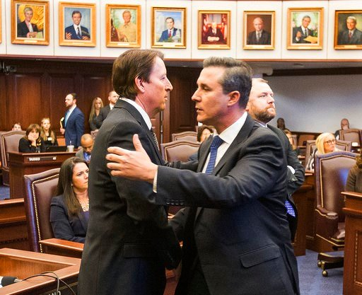 (AP Photo/Mark Wallheiser). Florida Sen. Rene Garcia, right, embraces Sen. Bill Galvano after Galvano's bill, the Marjory Stoneman Douglas High School Student Safety Act, passed 20-18 at the Florida Capitol in Tallahassee, Fla., Monday, March 5, 2018.